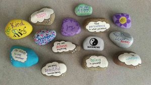 Beautiful assortment of painted rocks with inspirational messages painted on them