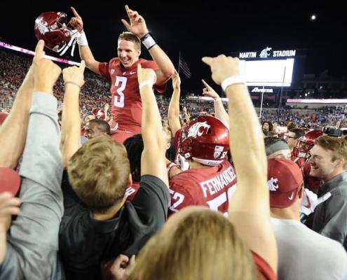 Tyler Hilinski hoisted on teammate's shoulders after a victory