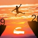 Leap year graphic of person jumping over a canyon