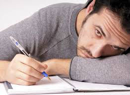 Man struggling to find the right words for a sympathy card